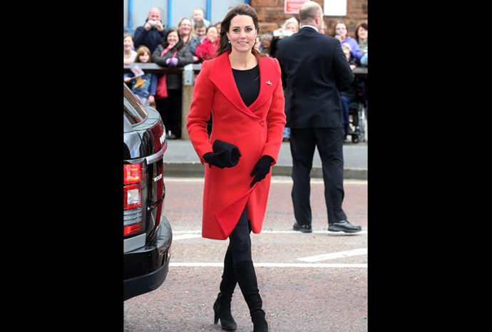 Catherine in a statement red coat .