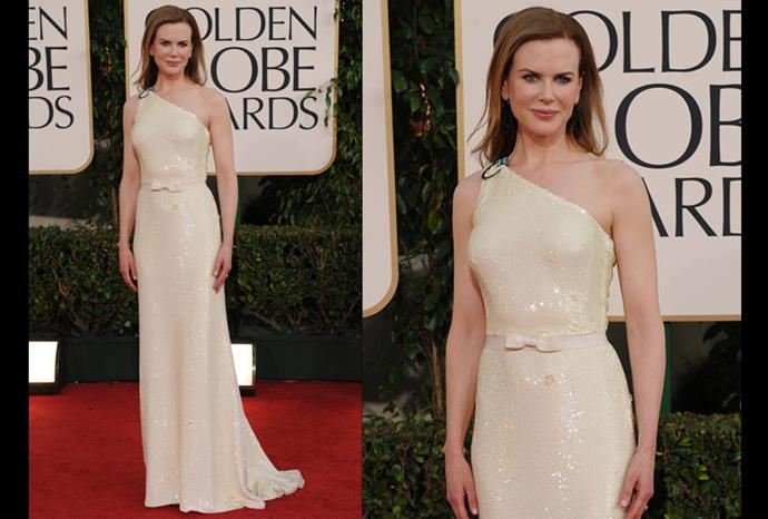 At the 2011 Golden Globes wearing a cream gown by Prada.