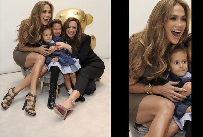 Jennifer Lopez thigh high skirt revealed her skin-tone spanx.