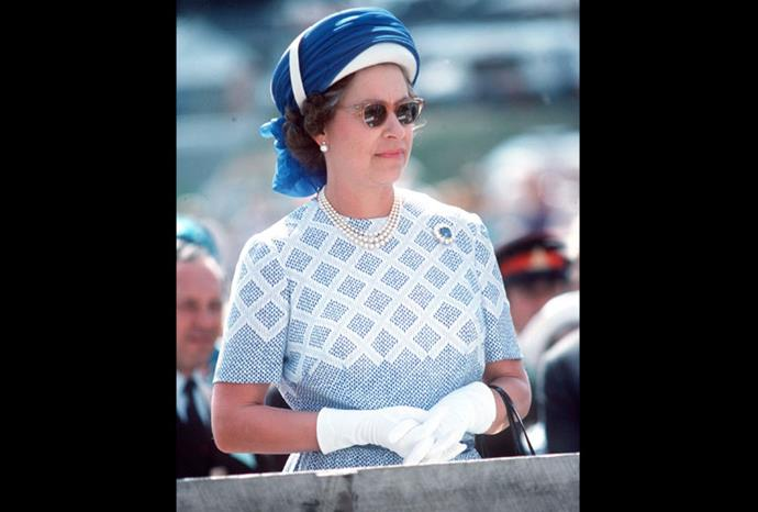 The Queen wearing a turban style hat during a visit to New Zealand in 1977.
