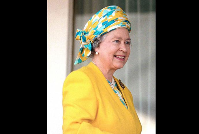 In one of her brighter styled hats, the Queen wears this yellow and blue combination.