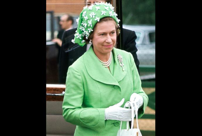 The Queen in 1973 wearing a green and white hat by milliner Simone Mirman.