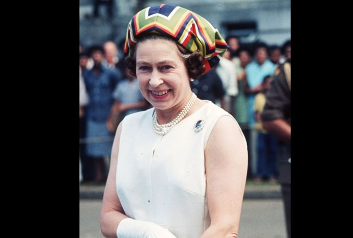 The Queen wears a colourful headpiece during a trip to Fiji in 1977.