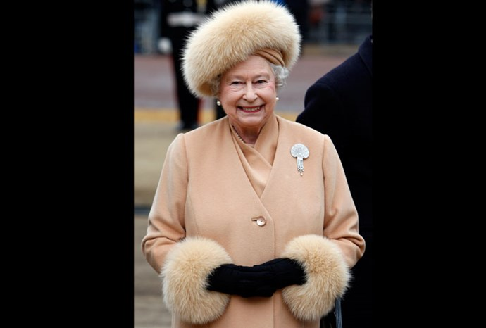 The Queen arrives to unveil a memorial to Queen Elizabeth The Queen Mother in 2009.