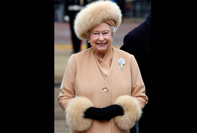 The Queen arrives to unveil a memorial to Queen Elizabeth The Queen Mother in 2009.