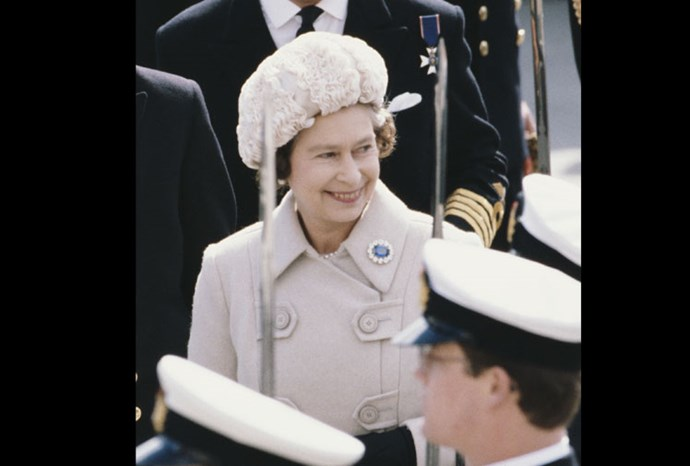 Sticking to a more neutral tone, the queen wears a soft pink hat in 1980.