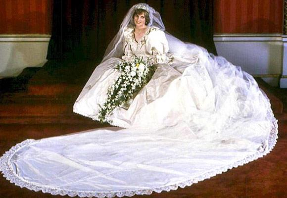 Princess Diana's hand-embroidered wedding gown had a full skirt over a multilayered, tulle petticoat, with bodice panels and had more than 10,000 tiny mother-of-pearl sequins and pearls. It also had an 8m silk train - the longest in royal history.