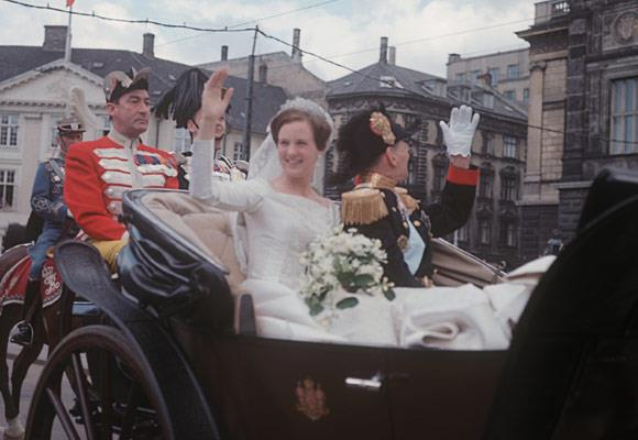 Queen Margrethe's 1967 wedding dress was a simple, yet elegant one made from satin and lace. The low square neckline dress was fitted around the waist with a full flowing skirt and long satin sleeves.