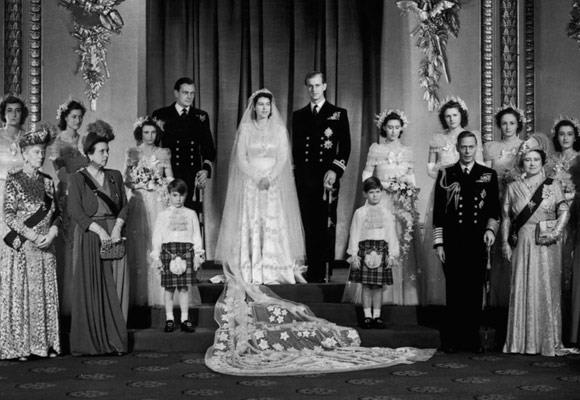 Queen Elizabeth II's 1947 wedding was the first royal celebration after World War II. In order to make her dress she famously collected ration cards in order to get the materials.  Her stunning dress, which was made by dressmaker Norman Hartnell, was made of ivory duchess satin and decorated with around 10,000 white pearls imported from the US, silver thread and tulle embroidery.