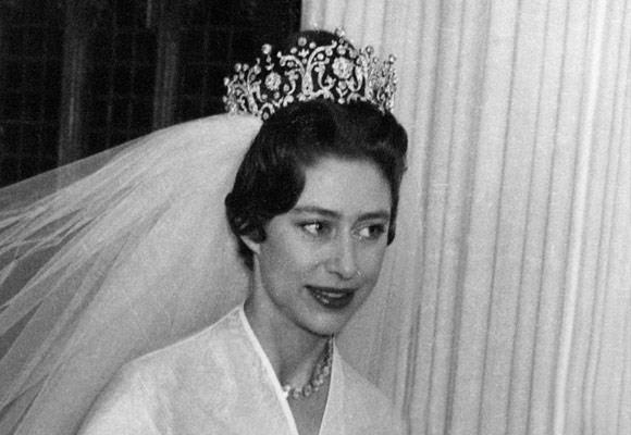 Her hair was wrapped up gracefully in the tall Poltimore tiara, which was made in 1870 for Lady Poltimore, and was purchased at an auction especially for Margaret's wedding day.