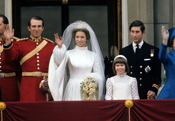 Princess Anne's 1973 wedding dress was an embroidered Tudor-style gown with a high collar and mediaeval sleeves.