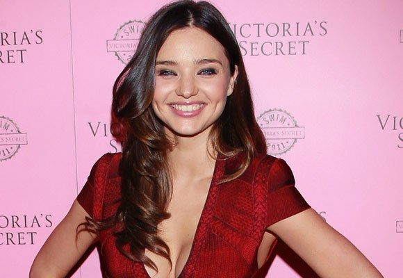 Miranda Kerr's free flowing long curly locks parted in the middle are a winner!
