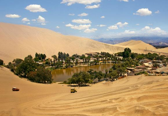 Nestled among towering sand dunes and sparse desert sits the beautiful Huacachina Oasis resort. The Peruvian legend of the lake is almost as beautiful as the setting itself, with locals believing the lagoon transformed from a small pool after a beautiful princess was disturbed bathing there.