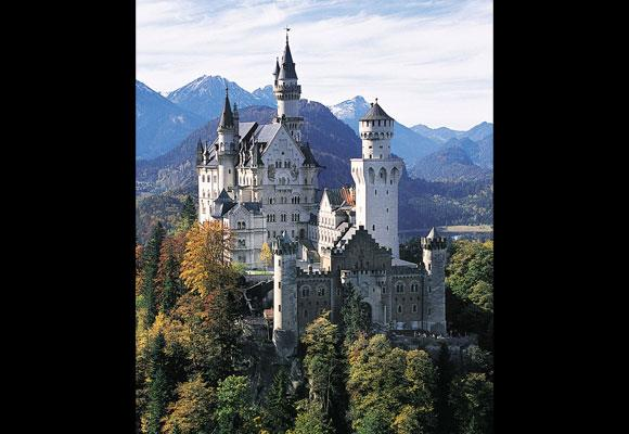 You'll feel like you've stumbled upon a fairytale kingdom when visiting this 19th century castle — and there's a reason why — it was the inspiration for Disneyland's Cinderella castle. Set on top of a hill overlooking the town, its magnificence will capture anyone's heart. *Image: Getty*