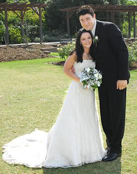 Olympic diver **Loudy Tourky** and AFL star **Simon Wiggins** celebrated their dream wedding in February 2007. The bride wore a strapless, satin, sequin-covered gown by US designer Maggie Sottero. At 187cm, Simon towered above his 147cm bride in the wedding photos.