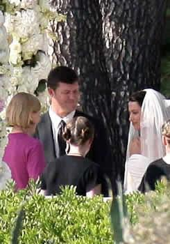 **James Packer** married **Erica Baxter** at the Eden Roc Hotel in Cap d'Antibes, France. The bride wore a white strapless three tiered gown with a lace veil. The wedding was attended by famous guests such as Tom Cruise and Katie Holmes.