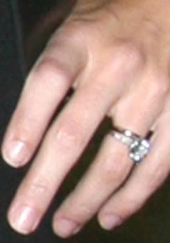**Kate Walsh** flashes her wedding ring.