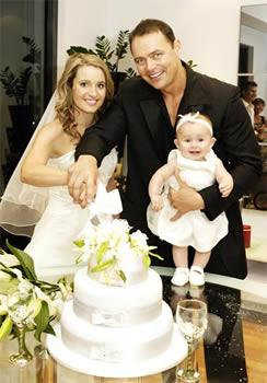 """*Big Brother 03* winner **Regina """"Reggie"""" Bird** married her beau of 18 months, **Dale Sorensen**, (pictured here with their 7-month-old daughter Mia) in a beautiful sunset ceremony at a luxury canal-front home on the Gold Coast. When her wedding planner quit at the last minute, Reggie had to go DIY on her own big day. """"I had to run down to the $2 shop to get ribbon, it was terrible!"""" she says.    **Read more:** [Reggie's romantic wedding](/article.aspx?id=311235
