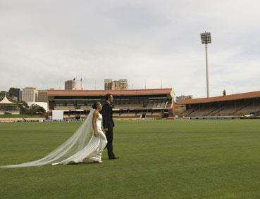 """There was a definite """"sporty"""" theme to Fitzy's 2008 wedding... they exchanged vows on a footy field!"""