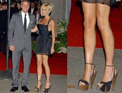 With her incredibly high wedges, Posh shows that fashion knows no pain.