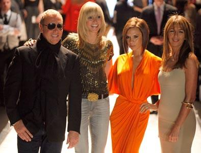 An fluorescent Posh styles it up with the best of them — designer Michael Kors, model Heidi Klum, and fashion director of *Elle* Nina Garcia — at the *Project Runway* season 4 collections.