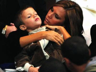Posh gives her son Romeo a hug just before cheering on hubby Becks in the International Friendly match between France and England on March 26, 2008 in Paris.