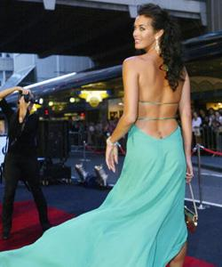 Megan Gale wears a flowing gown on the red carpet at the David Jones Launch Party at the Elizabeth Street Sydney store in November 2004.
