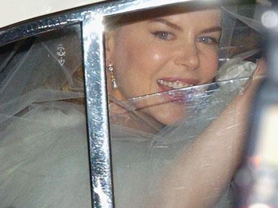 Still, the bride was beaming on her wedding day, held at St Patrick's College in Manly on June 25 2006.