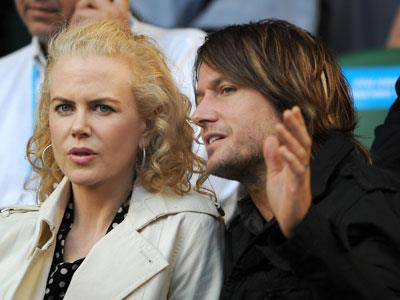 Here, Keith could be explaining the finer details of the showdown between Aussie Lleyton Hewitt and Serbia's Novak Djokovic of Serbia at the 2008 Australian Open. Is Nicole on the edge of her seat with the tennis action, or on the edge of her seat, ready to storm off?