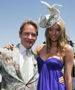 TV fashion stylist Carson Kressley poses with Jennifer. Does her hat match his coat on purpose?!