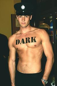 Jake, a carpenter-turned-model, strips off his shirt at the launch of the 'Eyes' fragrance from Police.