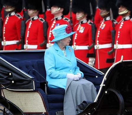 One of the guards hired to protect Queen Elizabeth was found to be an illegal immigrant who entered the army under a false name, causing red faces for palace officials.