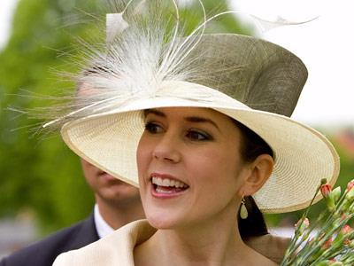 In summer, Mary's hats become a little more flamboyant.