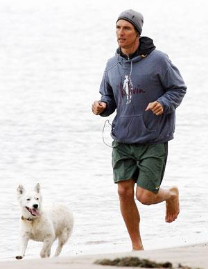 The actor likes to have company, courtesy of his new family dog Foxy, when he's running on the beach to maintain that impressive physique.