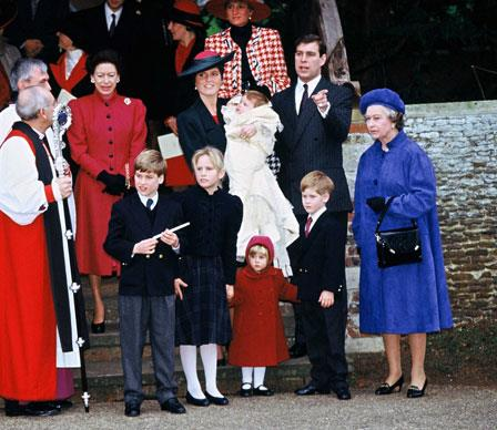 Holding court at the christening of her second daughter, Princess Eugenie at Sandringham in 1990, with the Queen looking on.