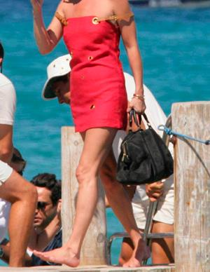 Which model, who is looking a little burnt across her shoulders, enjoys taking a walk along the pier?