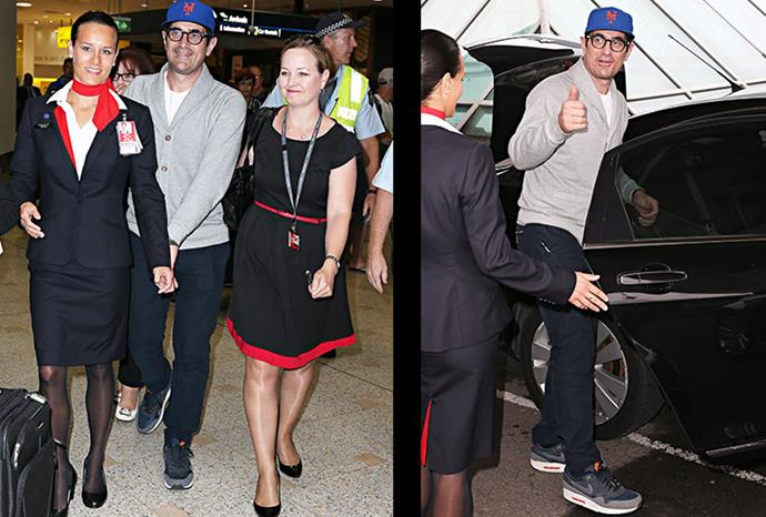 Ty Burrell waves to fans at Sydney airport.