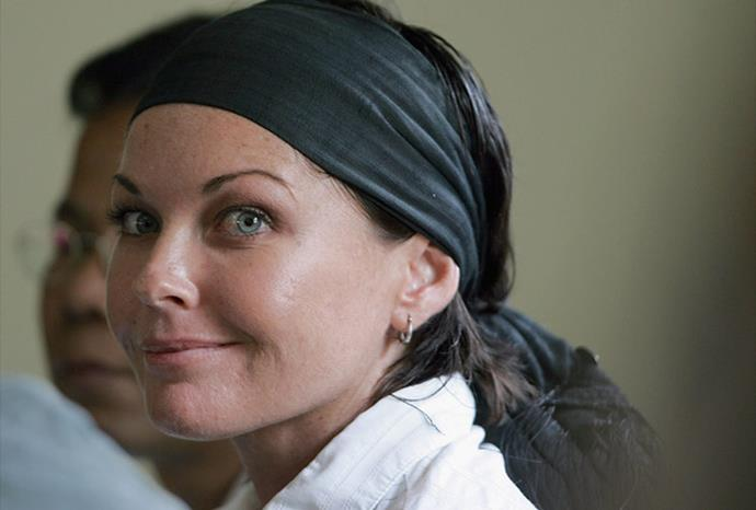 Corby manages half a smile during the judicual hearings in Denpasar District Court.