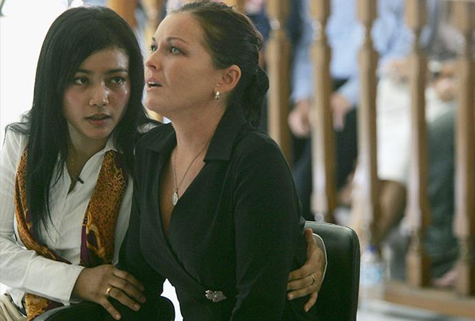Schapelle's translator Eka Sulistiowati tries to comfort her after passing on the news.