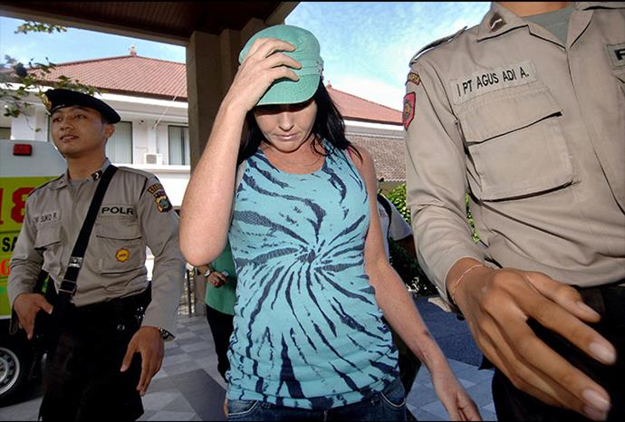 No place to hide: She tries to avoid the cameras after being spotted leaving a beauty salon.