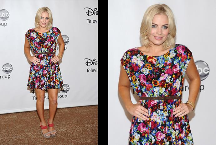 Showing off her new hair-style, she looks glowing in this floral number.