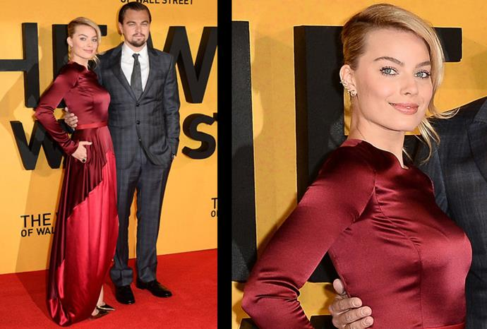 We don't know if it's the red dress or Leonardo on her arm, but she looks radiant.