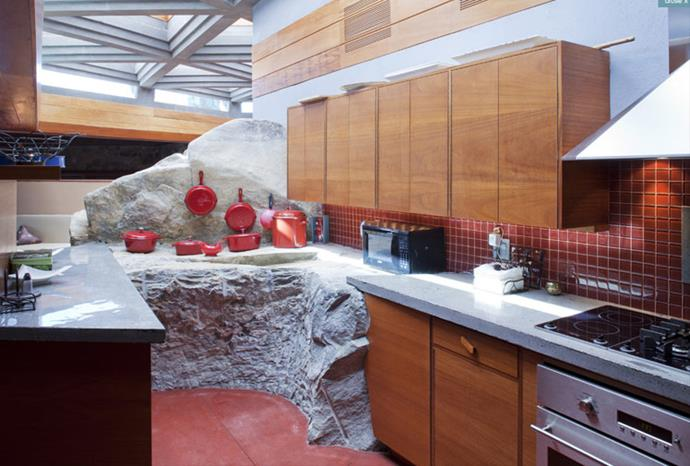 The kitchen is made up of the rock that flows right through the house.