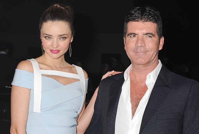 Simon poses with Miranda Kerr.