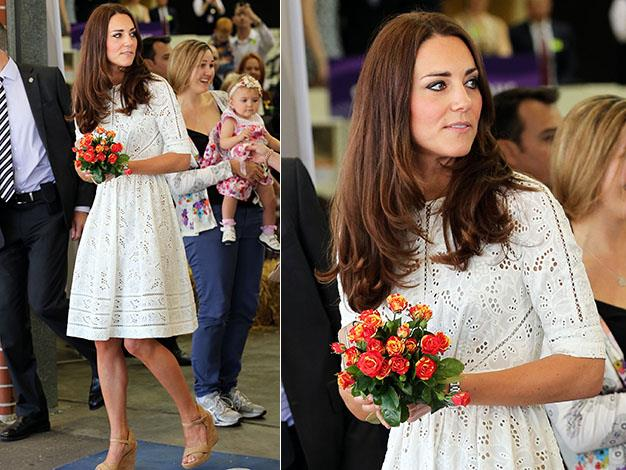 Kate holds one of the many bouquets of flowers received as a gift. Photo: Media Mode