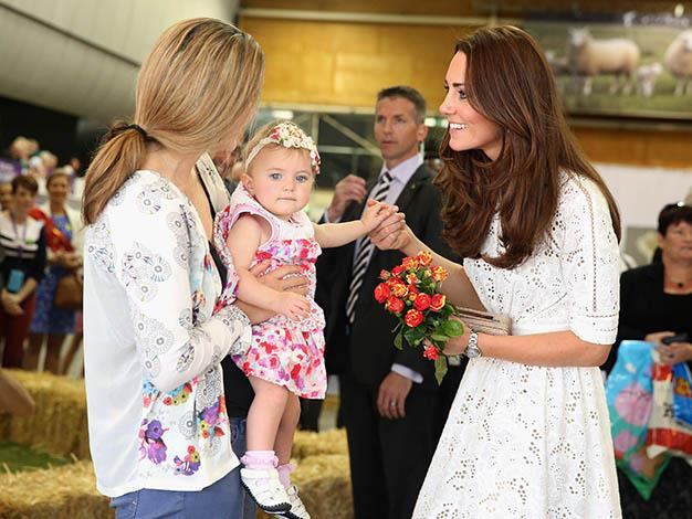 Kate can't resist stopping for some babies. Photo: Getty Images