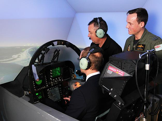His Royal Highness experiences a flight in the F/A18-F Super Hornet simulator. Photo: Department of Defence