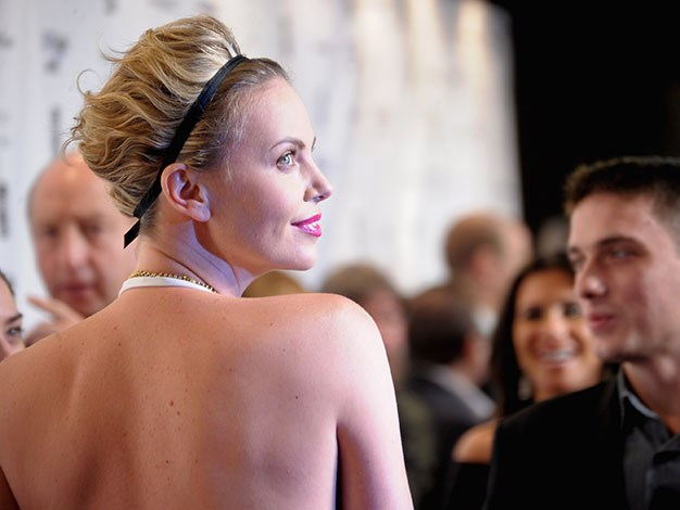 Charlize Theron's Back: The back not only has the ability to be one of the sexiest body parts, it's also important to train your back effectively to maintain good posture and to make you stand up straight and look taller.