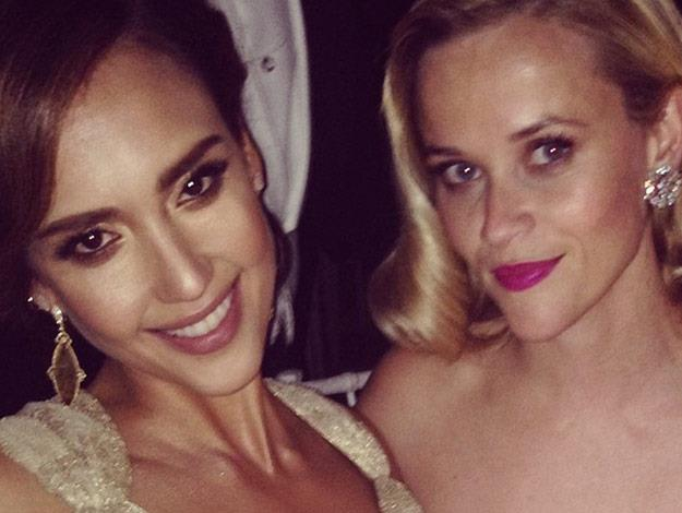 Actresses Jessica Alba and Reece Witherspoon pose for a selfie.