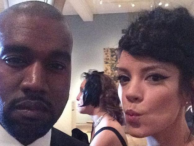 Lily Allen and Kanye West take a snap together.
